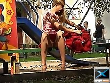 2 movies - Candid voyeur upskirt of a naughty coed pussy peeked out on the playground