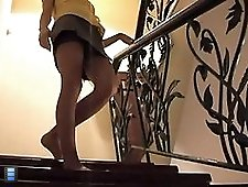2 movies - Mouth watering miniskirt upskirt video with chick in stockings going downstairs