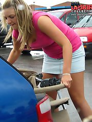 24 pictures - Upskirt car - voyeured while she puts something in a car