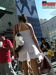 12 pictures - Panty upskirt - brunette in white dress voyeured