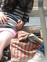 12 pictures - Very hot brunette in mini, up skirts sitting