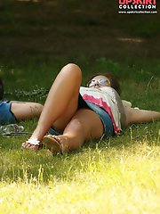 12 pictures - Simply upskirt - she's lying on grass and is being voyeured