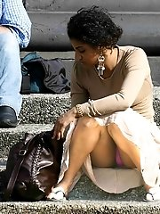 24 pictures - Upskirt of a squatting ebony beauty. Squat upskirt