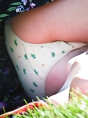 12 pictures - Sheer panties up bright skirt. Up skirt close up